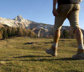 Hiker on hiking trail in South Tyrol