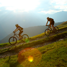 Mountain bike riders in hilly landscape
